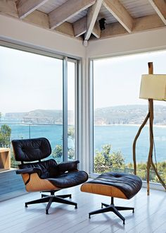 Ben's prized Eames lounge chair, with spectacular views to the beach.  Barney Rubble light by Mance Design. Photo - Sean Fennessy, production – Lucy Feagins / The Design Files.