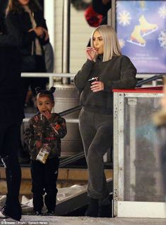 Like mother, like daughter: The adorable duo took a break from ice skating to watch the rink and enjoy snacks