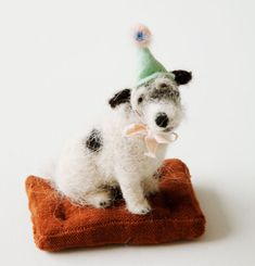 Domenica More Gordon's felted dog sculptures are just too cute.