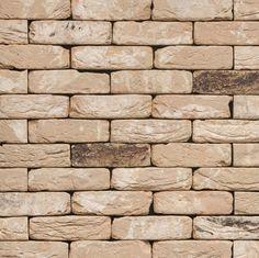 Parement en briques ton rouge brun rejointoyage ton cr me linteaux et frises en briques sur for Spot de noel pour facade