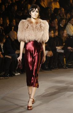 Fur, deep red and metallic - how many trends can you fit into one look? Masterful!