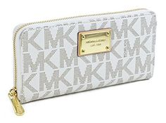 2b070f065eb6 Michael Kors Signature Zip Around Continental Wallet Vanilla Tone PVC. Made  of PVC. x x Zip Closure. Interior 8 card slots