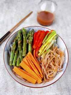 Recipe - Chilled Korean noodles with vegetables in spicy gochujang, fish sauce, rice vinegar and soy sauce. (vegan, vegetarian) Low fat, the perfect diet meal! For recipe, visit http://pickledplum.com/spicy-chilled-korean-noodles/
