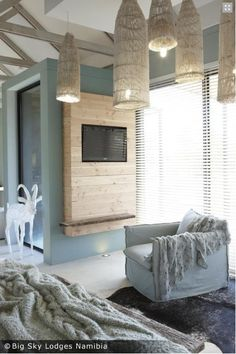 Rustic flat screen t.v. frame/mount...could easily diy...courtesy: FROM THE RIGHT BANK