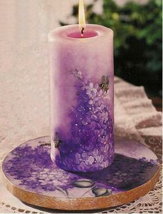 Lilacs on a plate and candle by Ginger Edwards.