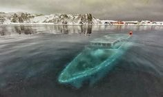 15 of the World's Most Strange Abandoned Places - Sunken yacht in Antarctica