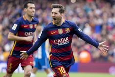 Barcelona's Leo Messi celebrates his first score during the Spanish league football match between the FC Barcelona and the RCD Espanyol at Camp Nou...