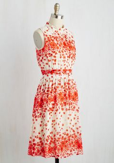 Cause a chic scene down the Magnificent Mile in this beautiful ivory frock - a ModCloth exclusive! Bedecked with a custom print of red-orange blooms, softly gathered details along its high neckline, and a cummerbund-style waistband, this A-line marks a landmark in your ever-stylish history! Love this dashing design? Check it out in a host of other haute hues!By the way, this lovely item will be available for purchase in Feburary!