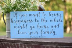 If you want to bring happiness yo the whole world, go home and love your family Mother Teresa wood sign  Hey, I found this really awesome Etsy listing at https://www.etsy.com/listing/450097450/if-you-want-to-bring-happiness-to-the