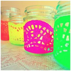 DIY neon tealights created from neon doiles and glass jars. Created by Oh So Sweet Occasions for an 80s themed tea party.