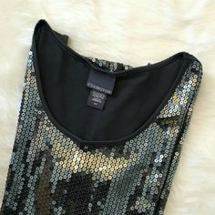 • Sequin Tank top • Selling this gray sequined tank top. Perfect for the holiday season! It's been worn maybe once, in perfect condition, and can fit a small to medium build. Covington Tops Tank Tops