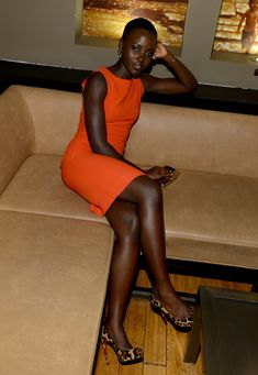 Lupita Nyong'o in bright orange. She just rocks these bright colors. So cool.