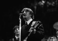 Paul McCartney and John Lennon on stage at Cincinnati Gardens. The Beatles did a dozen songs in about 28 minutes – with the crowd screaming the whole time.  photo by Walter Burton