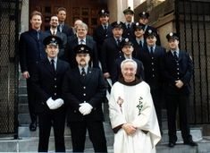 Father Mychal Judge, NYFD Chaplain, with his beloved firefighters.
