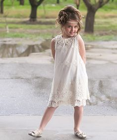 Lace and pearl accents add vintage-inspired charm on this pretty girl's dress.