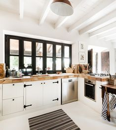 black windows white kitchen luggage hardware and butcher block counters