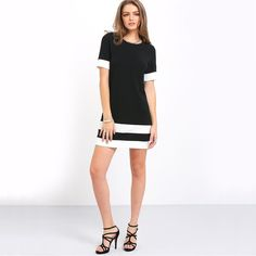 Be stylish and comfortable in the Black Sleeved Dress with Bold White Stripes, perfect for casual Summer styling!