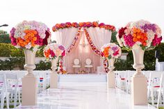 Orange, Purple and pink themed decor for Jaya and Alex's wedding