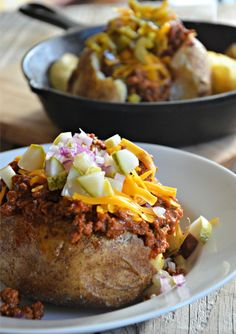 A super easy slow cooker recipe for Turkey Sloppy Joe Stuffed Baked Potatoes mountainmamacooks.com.