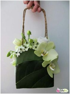 Flower purse. Even without a strap this would be a pretty arrangement for a tabletop.