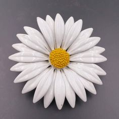 Check out this item in my Etsy shop https://www.etsy.com/listing/517608003/big-white-yellow-daisy-flower-pin-1960s