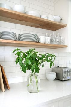 Stick-on subway tiles and fake marble countertops are all the rage right now, especially for apartment-dwellers. Check out this example from Our House which perfectly incorporates these look-alikes.