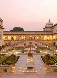 The Rambagh Palace (former residence of the Maharaja of Jaipur), built in 1835, in Jaipur.  Enjoy a visit to the gardens here as well as High Tea. by Charlotte Fisher