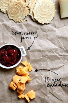 The Perfect Cheese Plate - Thank you Joy the Baker!  - How cute is it to use parchment paper/brown bags and sharpie to label the cheeses and such.