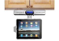 Innovative Technology Under cabinet IPAD dock.  Has clock radio, 2 stereo speakers, amd remote control.
