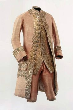 Men Suit, 1780, Switzerland. Pink silver brocade with rich embroidery in gold. Consisting of Frockcoat, waistcoat and breeches....