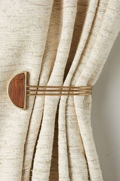 Hemisphere Tieback by Anthropologie from Anthropologie. Saved to curtains . Shop more products from Anthropologie on Wanelo. Curtain Accessories, Home Accessories, Bohemian Room Decor, Bohemian Apartment, Apartment Living, Home Decoracion, Curtain Hardware, Curtain Tie Backs, Curtain Rods