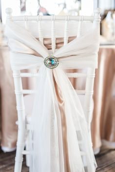 simple and elegant: wedding chair with broach to tie chiffon fabric