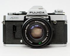 ($45.00) The Fujica AX-5 is a 35mm SLR with manual, aperture priority, and shutter priority modes. The shutter is electronic and requires a battery for operation. Everything seems to be in working order. The shutter works on all speeds and sounds accurate. Film advances and rewinds properly. The meter works and seems accurate. The lens is clean, with smooth focus and snappy aperture.