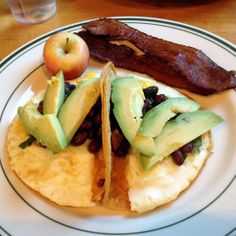 Fried egg tacos with avocado and black bean salsa, with a side of bacon at Cafe DeLuxe in Reno.