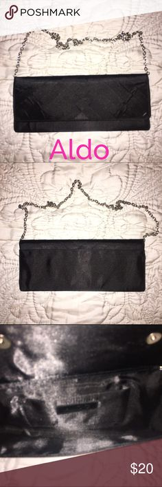 "NWOT ALDO Black Satin & Silver Clutch - R$45 NWOT Aldo black satin clutch with silver chain. Two magnetic snap closures. Chain can be hidden inside to make it a clutch. Inside pocket. Pristine condition. Measurements: 10"" length, 5"" height. Retail $45.  ✅Always Authentic✅ ⬇️Bundle & Get 10% Off & Save on Shipping⬇️ ❌Trades❌PayPal❌ ALDO Bags Clutches & Wristlets"