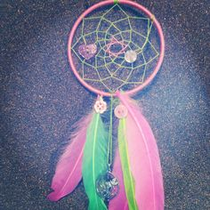 Lime Green Dragon(fly) two toned dream catcher.  Buttons and feathers and a whimsical pink dragonfly pendant.