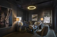 Moody Media room with vintage pieces and a lacquered ceiling - Media  MidCentury Modern by Rinat Lavi Interiors (=)