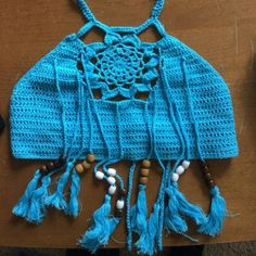 Tassel fringe crochet brallete/ top Tassel fringe crochet brallete/ cami top. This is very great piece of choice for summer. Great to pair with short or bikini bottom. One strap side very unique way to tie on back. Fits 32A 32B 34A 34B 34C 36B 36C  82% cotton 16% polyester Soft and comfortable with some stretch giving. MiraBelle boutique Swim Bikinis