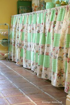 English Country Cottage | The Utility Room with patchwork curtains made from old fabrics. www.vintage-home.co.uk