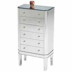 "6-drawer jewelry cabinet with mirrored panels and chamfered edges.   Product: Jewelry cabinetConstruction Material: Asian hardwood, glass and acrylic  Color: MirroredFeatures: Six drawersTwo side compartmentsDimensions: 34"" H x 18.5"" W x 10.5"" DNote: Assembly required"