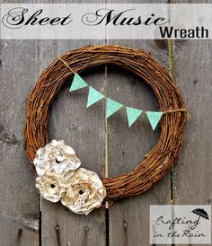 Simple wreath idea. In love with those sheet music flowers! #wreath