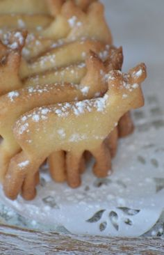 Instead of the too sweet frosting for sugar cookies just dust with a sprinkle of powdered sugar,
