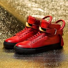 """Buscemi 100mm Leather High-Top Sneaker Details #ONLYATNM Only Here. Only Ours. Exclusively for You. Buscemi men's high-top sneaker in pebbled calfskin leather with golden hardware. 1"""" heel; shaft, approx. 5.25""""H (100mm). Round toe. Lace-up front. Ankle strap with gold-tone bar; engraved logo at front. Oversized pull loop with key and pocket accent. Tonal topstitching. Leather lining and insole. Contrast rubber outsole. Made in Italy. Designer About Buscemi: Consumer first, designer…"""