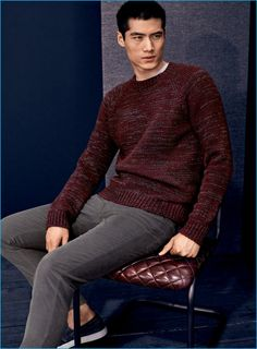 Hao Yun Xiang dons a marled sweater, corduroy pants, and slip-on sneakers from Vince.