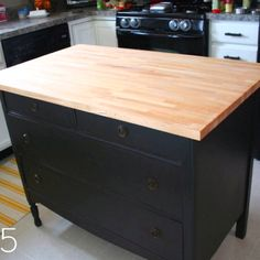 5.  This one began as a dresser and found new life and purpose in the kitchen as a great island.  You can find the before, after, and tutorial at Sanity and Chaos.  Website: http://www.curbly.com/m/11081-round-12-diy-kitchen-tables-islands-cuboards-you-can-make-yourself