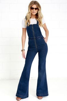 You asked for style and the Rollas Eastcoast Dark Wash High-Waisted Denim Flare Overalls are here to deliver! Medium-weight, stretch denim overalls have a silver zipper-accented bodice supported by adjustable straps that crisscross at back. High, banded waist transitions into flaring pant legs with diagonal front pockets and back patch pockets with logo tag.