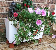 Make a beautiful ceramic flower planter out of your old toilet tank!
