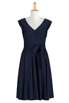 I <3 this Allison dress from eShakti  -  navy blue or black, pleats, seam detail, classic, a bit dressy.  check out the entire site, nice clothes with tailoring available, decent prices, fast service, very large size range.        lj