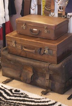 i want stacked vintage leather suitcases as an end table next to my bed one day!!