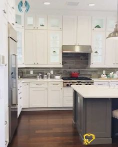 White Kitchen + Open Concept Living New home model by Toll Brothers includes white kitchen cabinets, quartz countertops, open concept living and hard wood flooring. #floridaliving #HomeInteriors #WhiteKitchens<br>